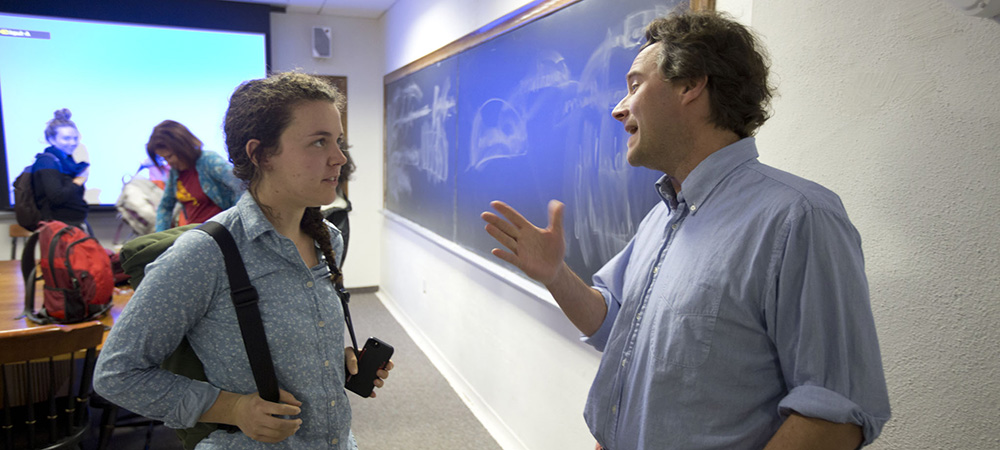 student talking with Professor Chiasson