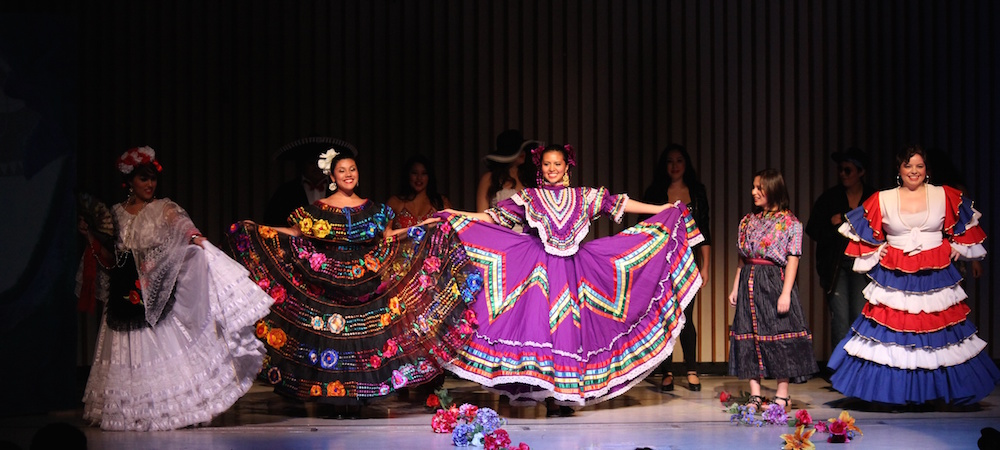 Dancers are on stage during the Latina Culture Show