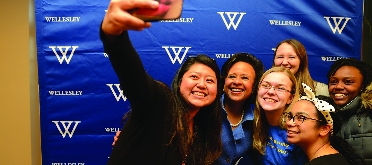 President Paula Johnson takes a selfie with Wellesley students