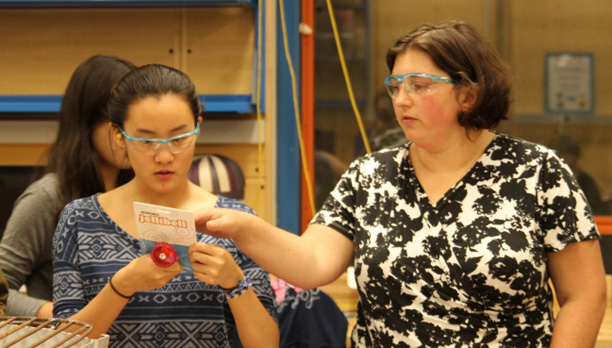 Amy Banzaert instructs a student in the lab