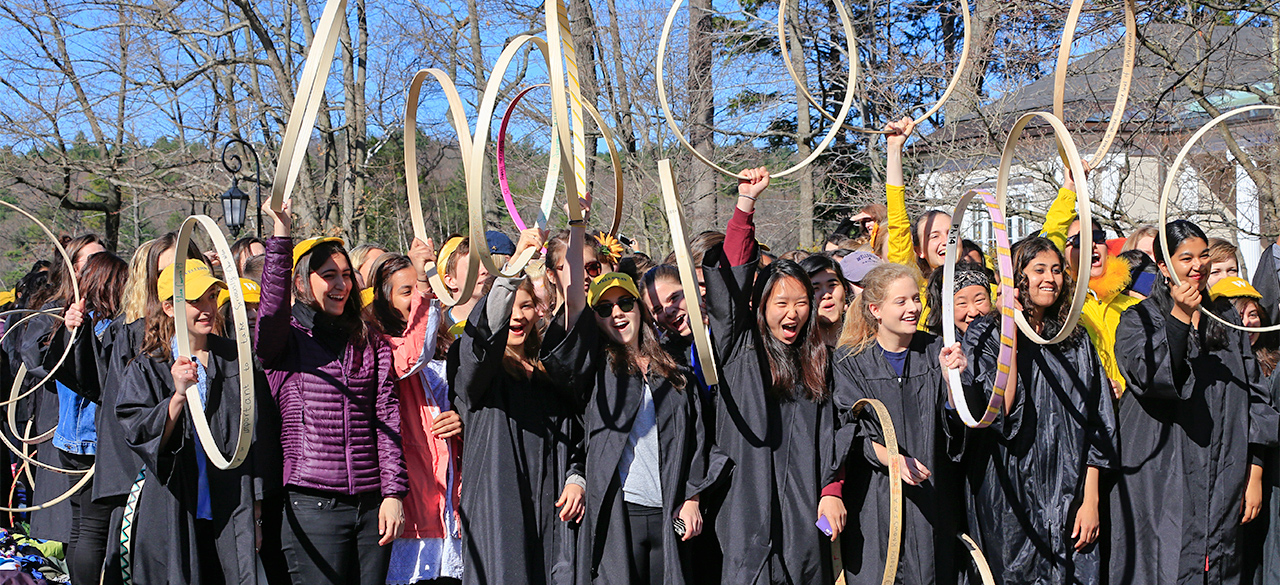 Wellesley seniors compete in the 120th Hooprolling competition.
