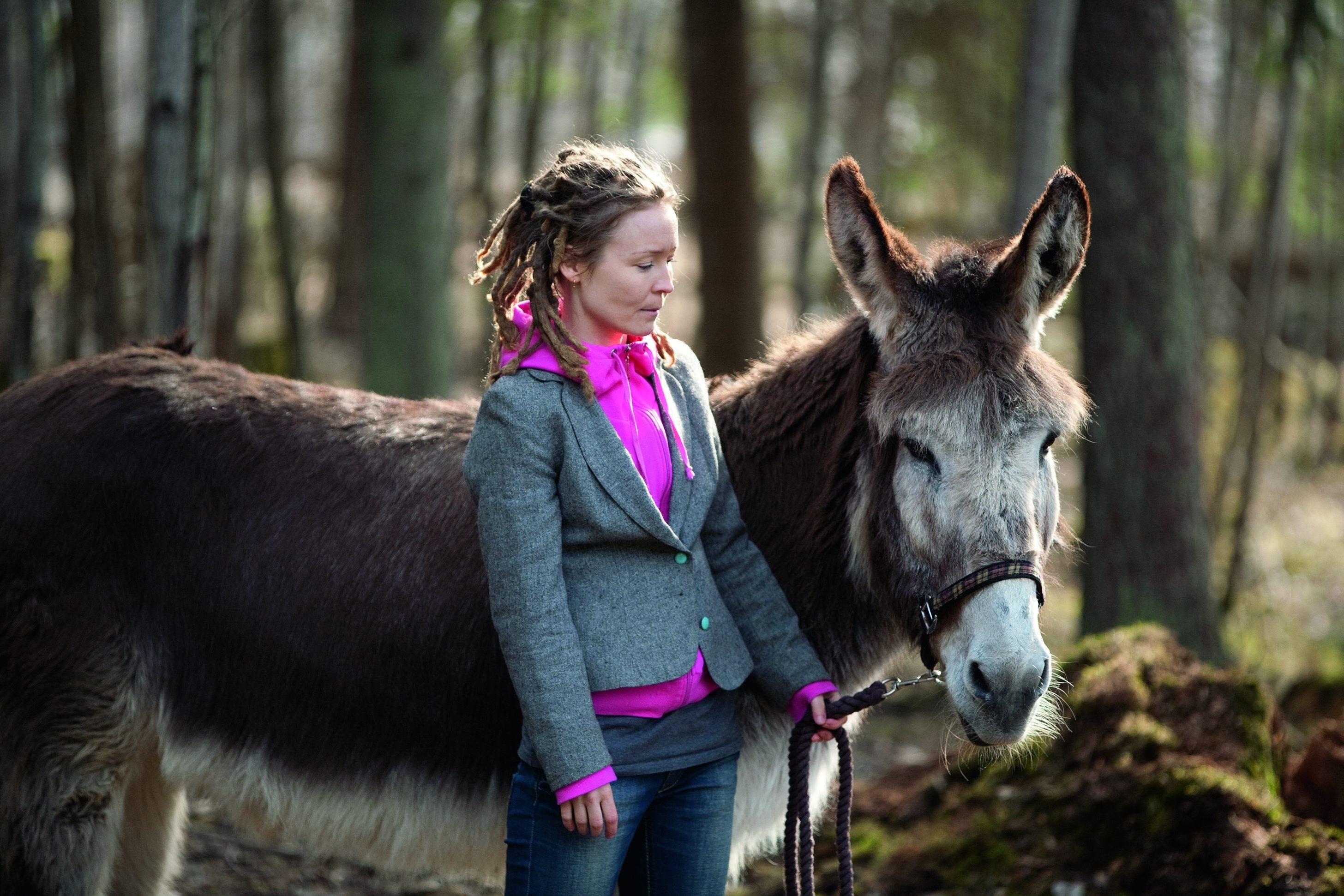 woman with donkey from aija-liisa ahtila's exhibition