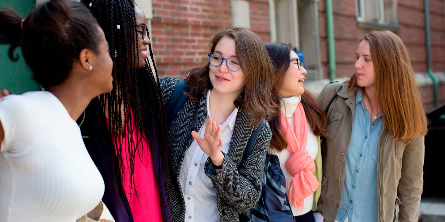 students talking outside a building