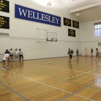 Playing badminton in the multipurpose gym