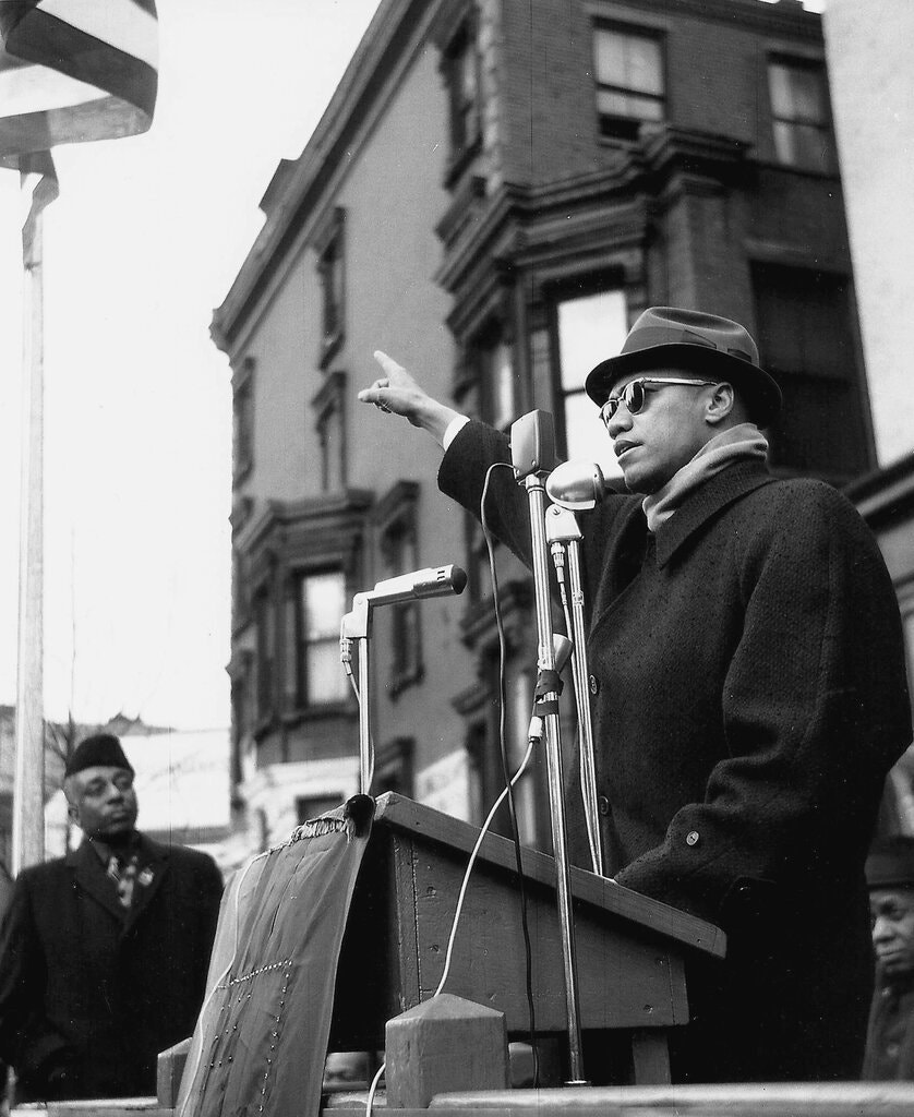 Malcolm X, speaking at a Harlem rally around 1962