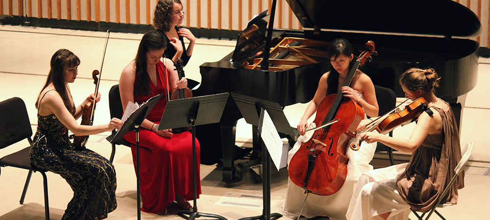 Students preforming in a string quartet