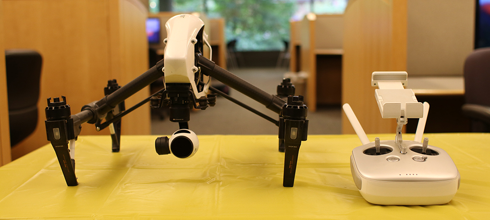 A small drone sitting on a table