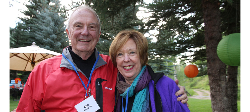 Betsy and Bud wearing jackets at an outdoor event