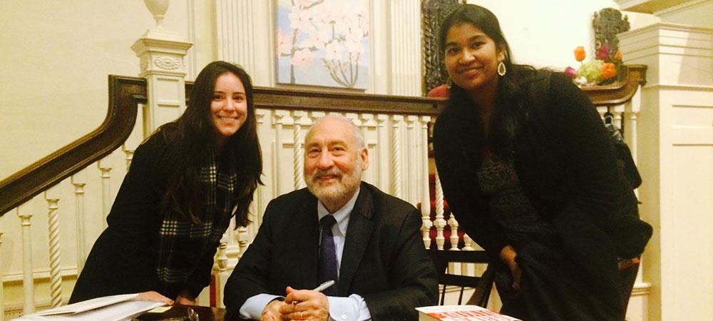 Two students with Joseph Stiglitz