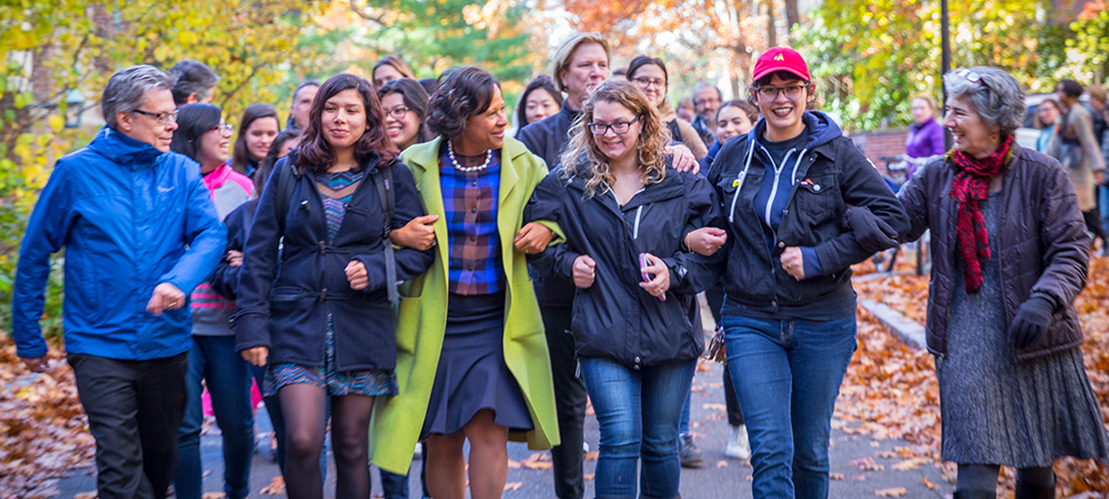 President Paula Johnson walking with students and staff