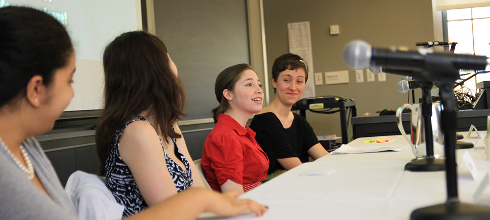 Four students present on a panel during the Ruhlman Conference