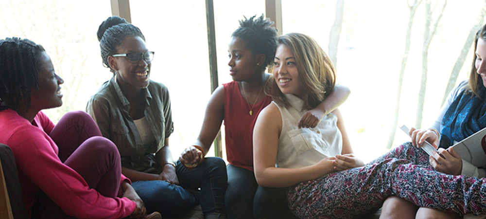 Friends hang out in Anderson Forum a gathering spot on capus