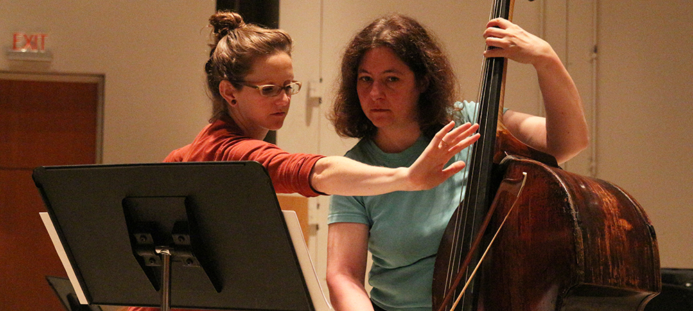 Student and teacher practice the bass