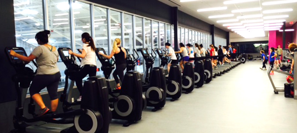 students on elipticals in the fitness center