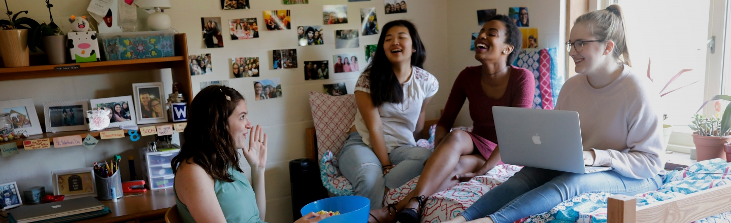 students hanging out in a dorm