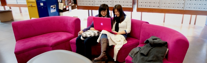 students on a pink couch