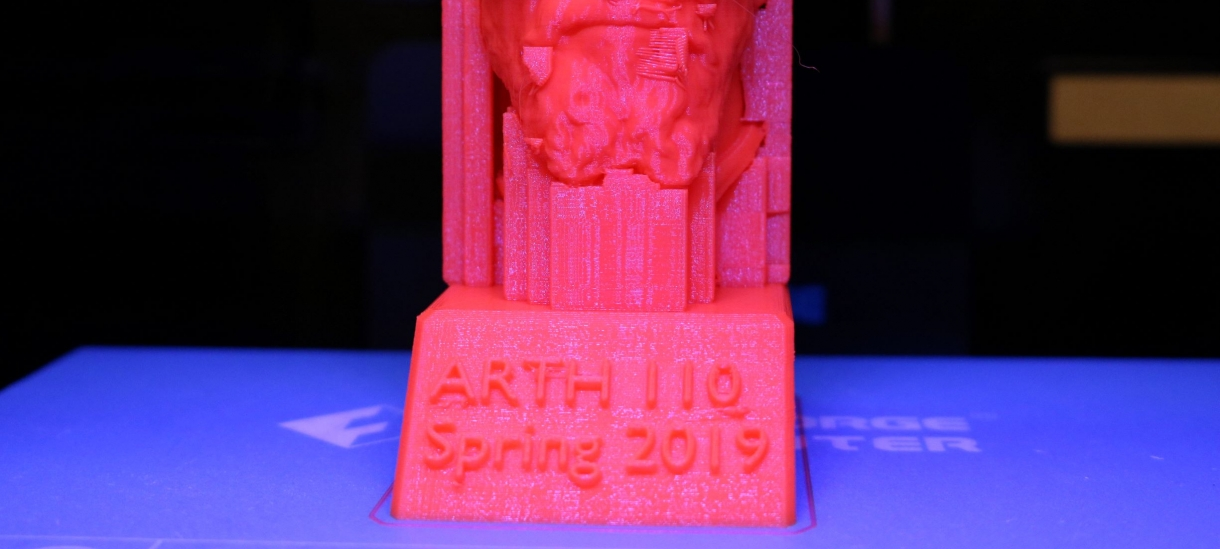 "An in-progress image of a 3D print with a base that reads ""ARTH 110 Spring 19""."