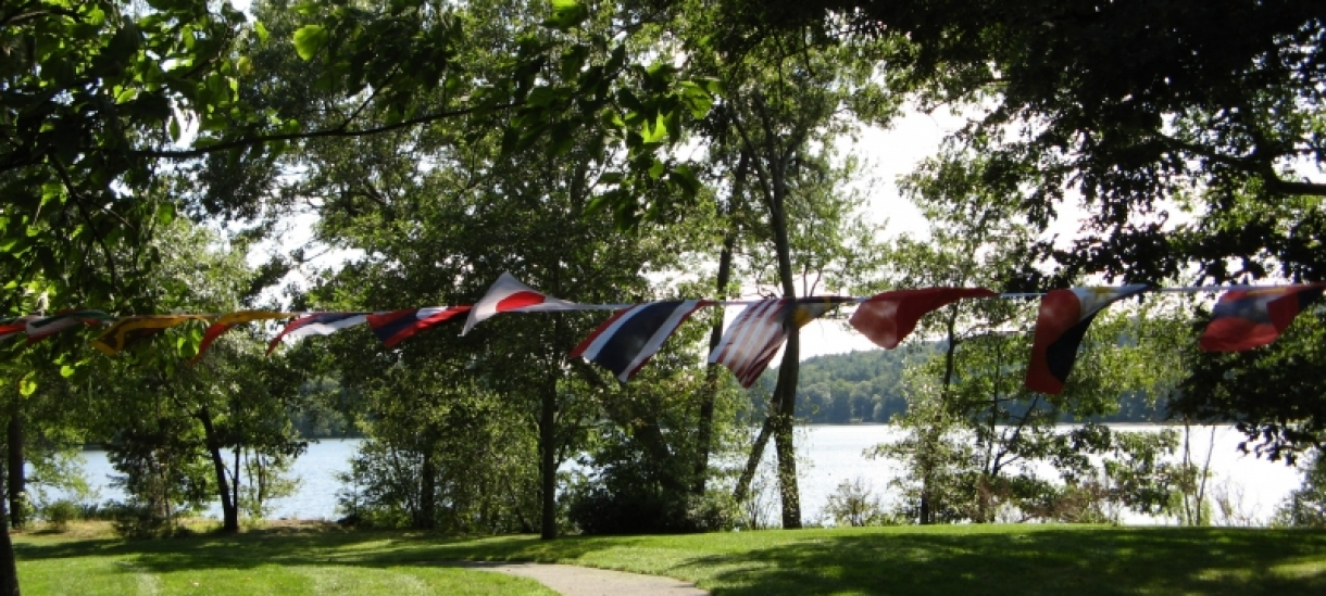 Flags hanging by Lake Waban