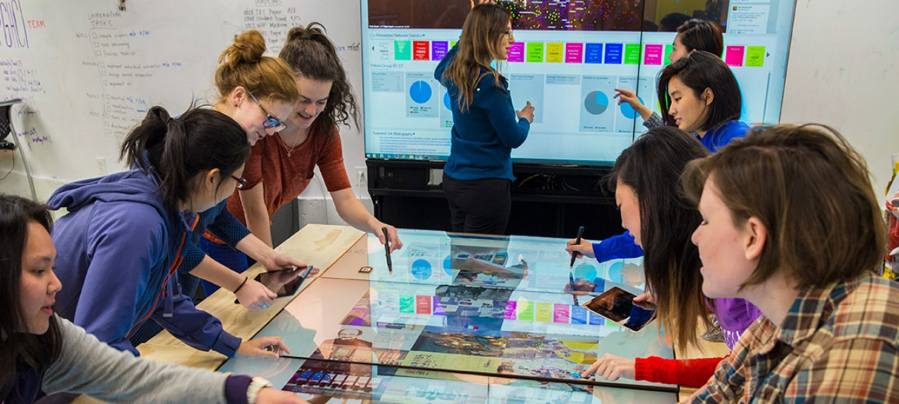 students work together on a tangible user interface