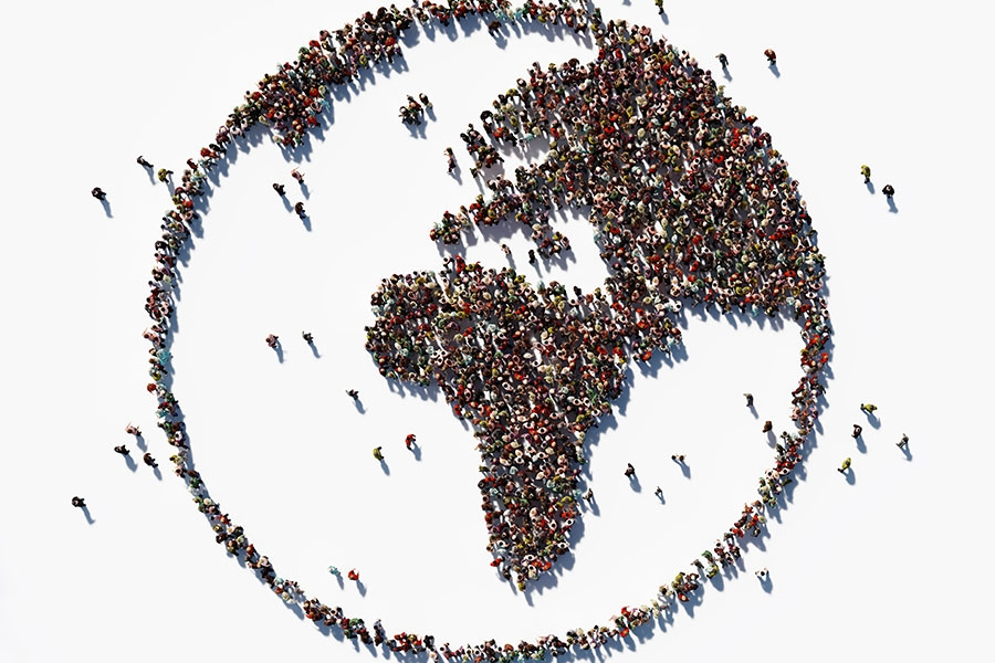 image of people standing in the shape of the world globe.