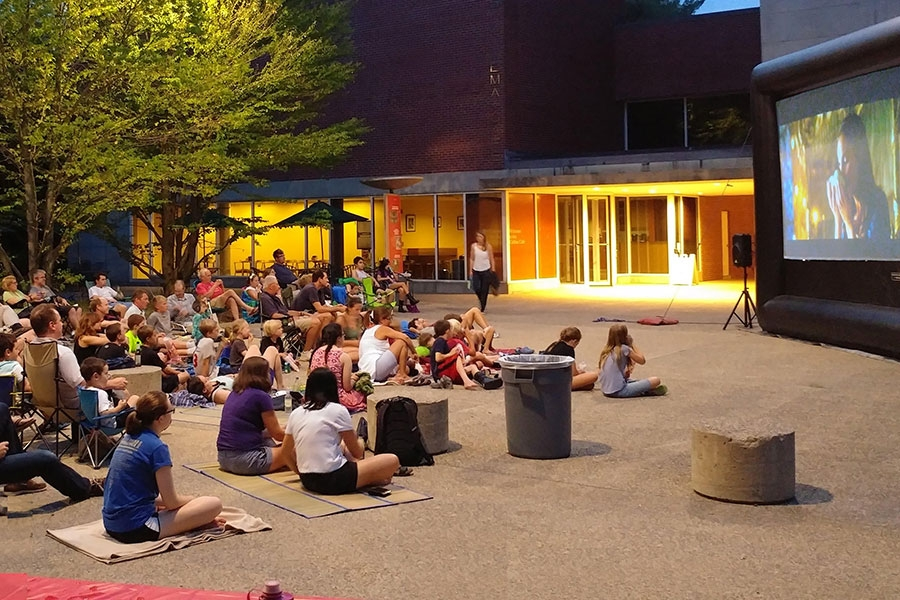 People sitting on the Davis Plaza viewing an outdoor film