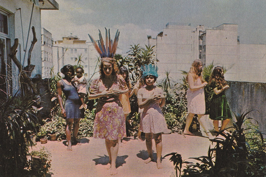 image of girls in feather headdresses