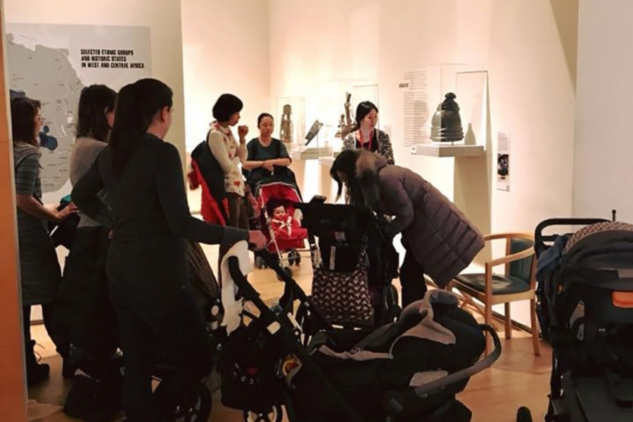 People with children in strollers in the Davis museum