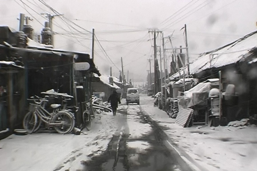 still from Wang Bing's film west of the tracks