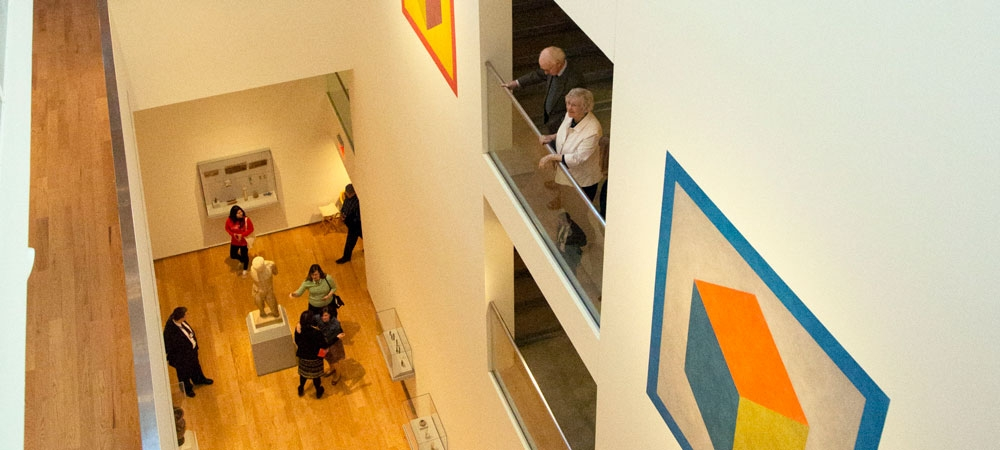 Visitors take in an exhibition at the Davis Museum