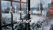 "screenshot from Wellesley holiday video showing open window with snowy view and the words, ""A time to make memories"""