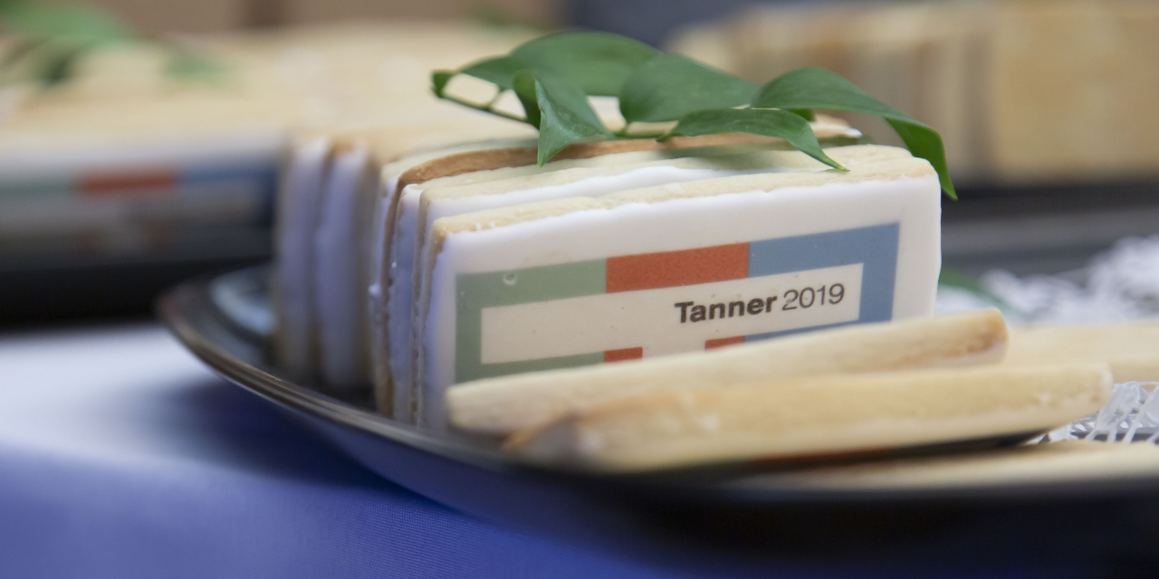 Cookies with the Tanner logo sit on a table.