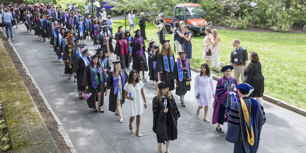 With Wellesley's 140th commencement exercises about to begin, the class of 2018 lines up outside of Green Hall.