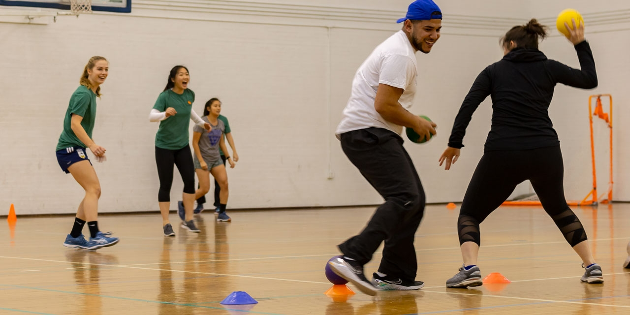 Student athletes and staff members play dodgeball.