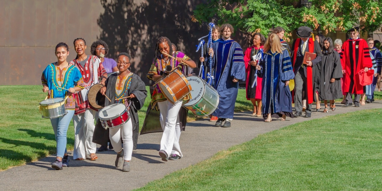 Students with drums lead the convocation procession from the Campus Center to Alumnae Auditorium.
