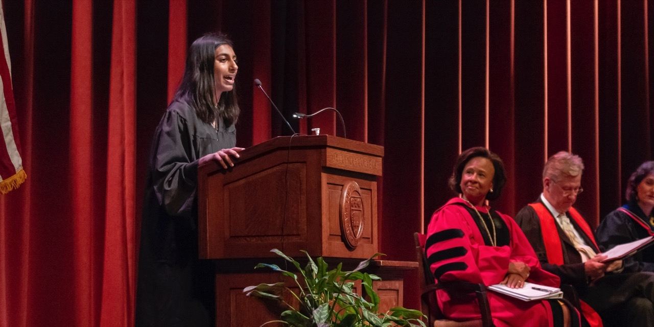 Student speaker Maya Nandakumar gives her address to the student body as President Johnson and Provost Shennan look on.