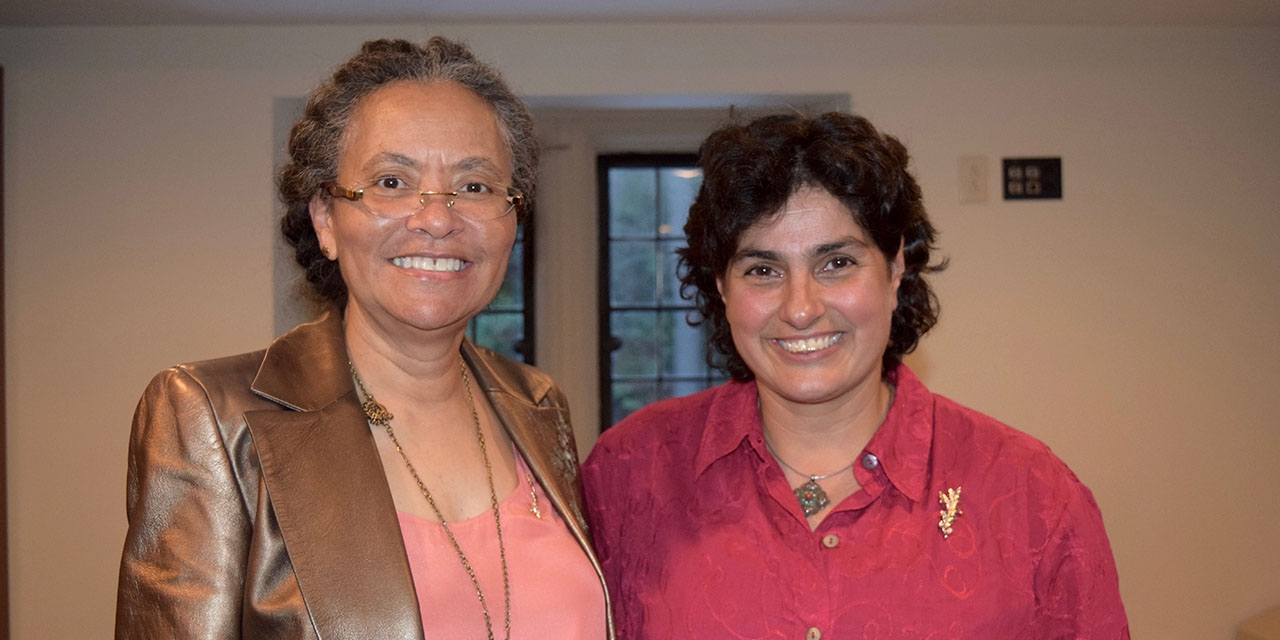 The two alumnae achievement award honorees pose together for the camera.