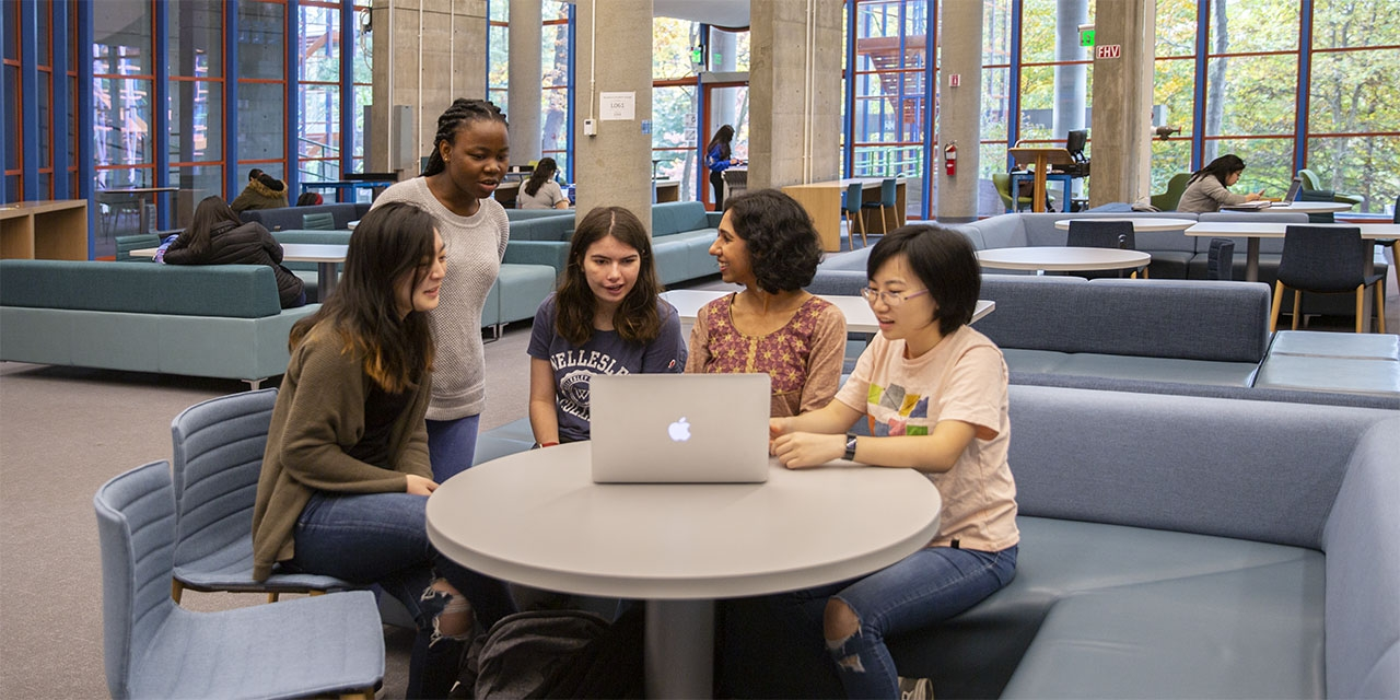 Students and a professor sit in the new science center