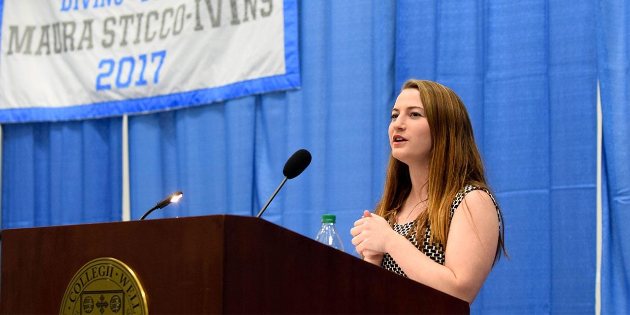 Maura Sticco-Ivins '18 speaking at podium