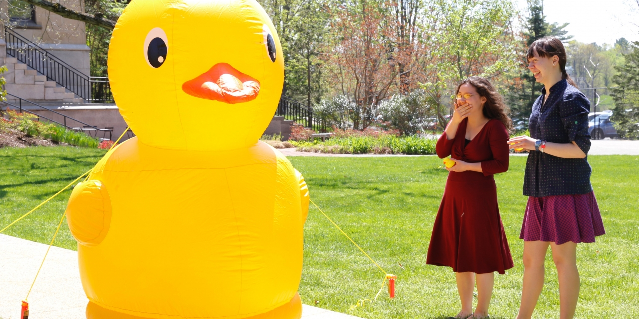 A human sized, blow up duck stands guard outside the Houghton Memorial Chapel