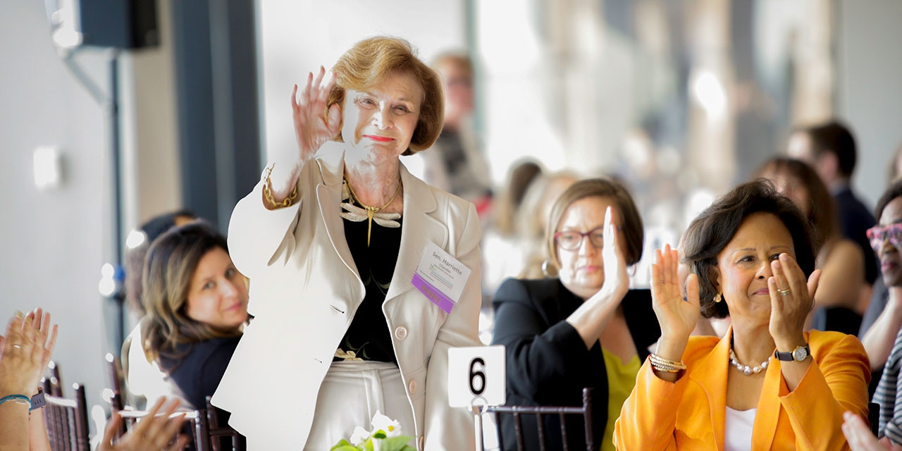 Harriette Chandler waves to a crowd.