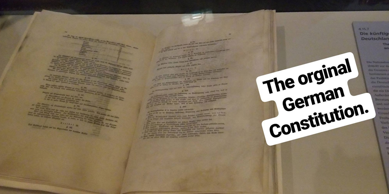 Image of the original German constitution at the German Historical Museum in Berlin. Text reads The original German Constitution