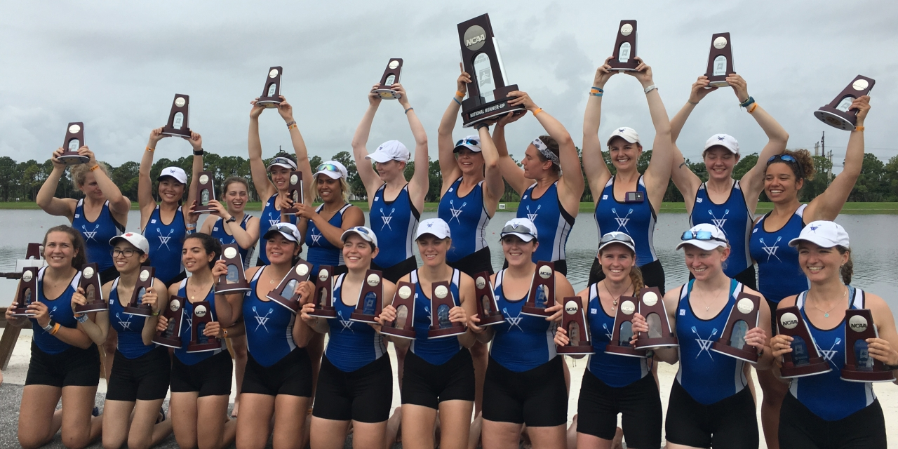 The Wellesley Blue Crew team holds up trophies after placing in national competition