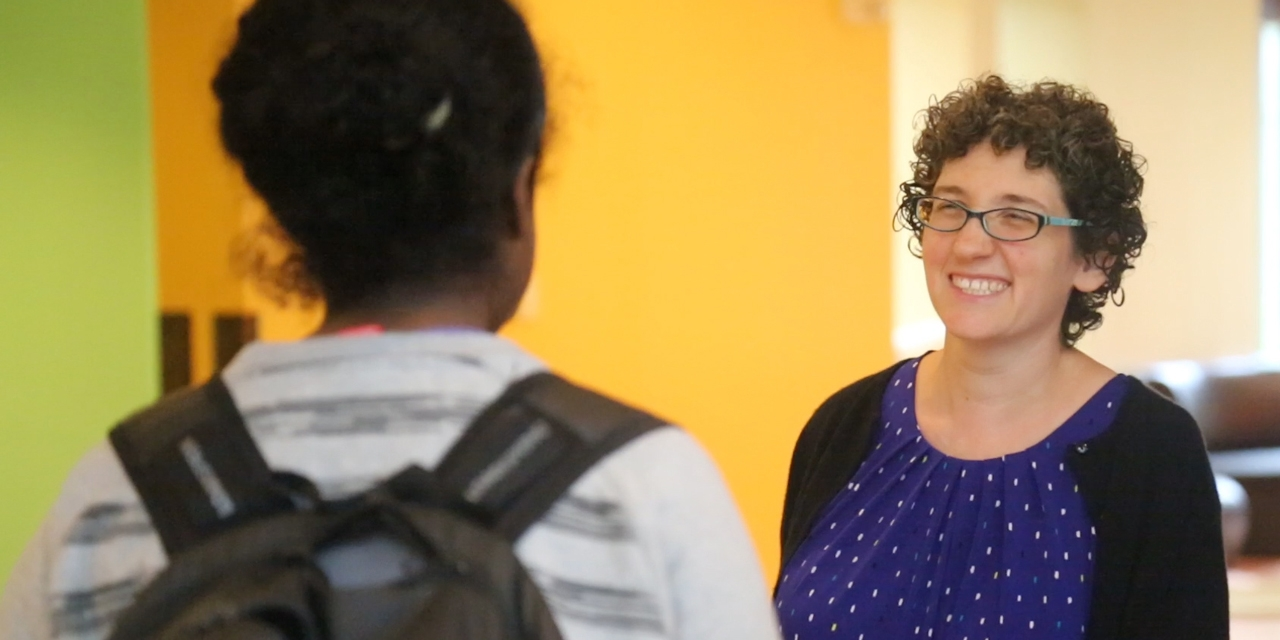 Rabbi Dena Bodian speaks to a student in Tischman Commons