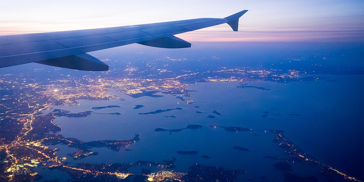 An airplane preparing to land over Boston's Logan airport