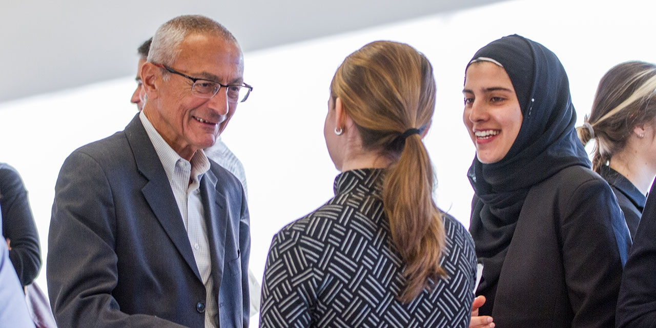 John Podesta speaks to two Albright Fellows.
