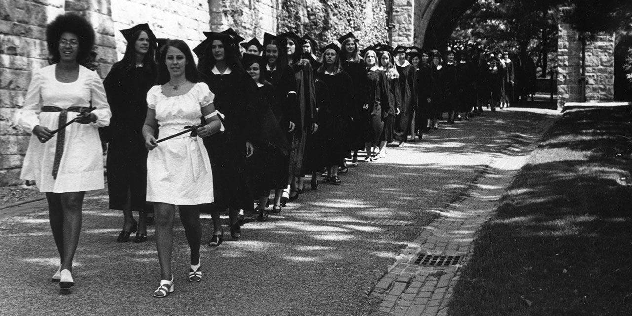 Student marshals lead the baccalaureate procession outside Green Hall during 1972 commencement ceremonies.