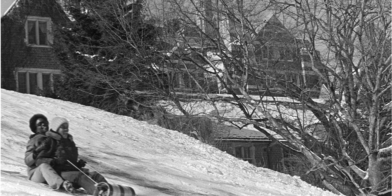 Wellesley students sled down Severance Hill.