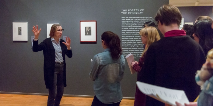 Student guides look at exhibitions in the Davis Museum.