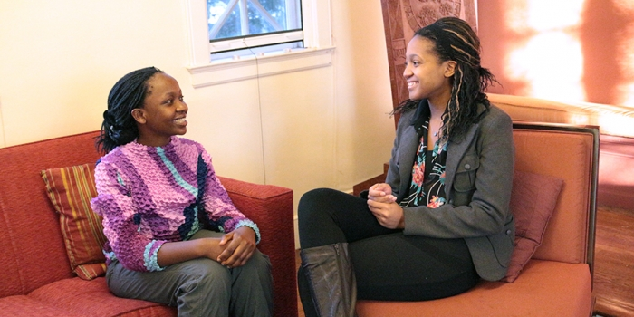Wellesley's MasterCard Foundation Scholars, Martha Aywa and Refilwe Kotane, talk together in Harambee House