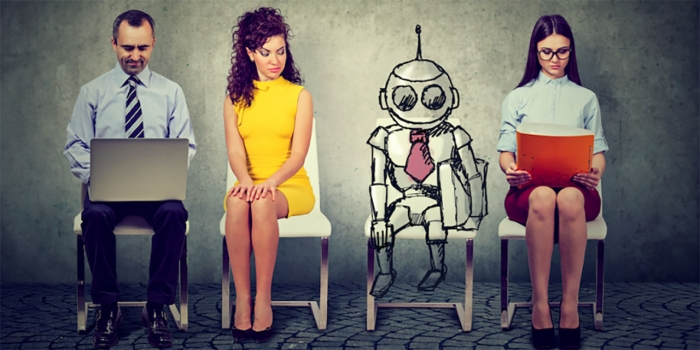 Three humans and a robot sit outside an interview room.